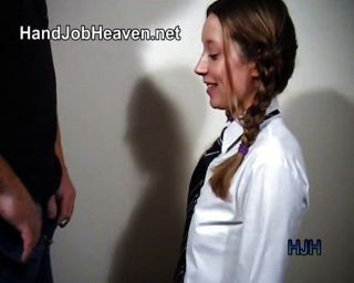 Pigtailed College Girl Gives A Handjob