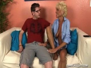 Sluty Mature Lady Jerks Off A Young Guy