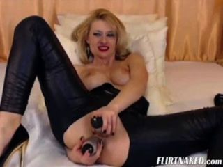 Camgirl In Leather Having Orgasm