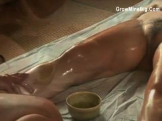 Japanese Lesbians Sensually Rub Oil On Each Other