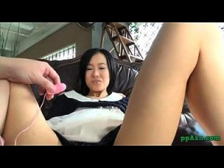 Asian Lolita Getting Her Hairy Pussy Stimulated With Vibrator On The Couch In Th