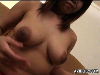 Asian Bimbo Is On Her Wet Cunt Masturbating With A Toy