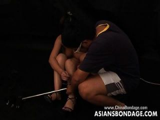 Bound Asian Whore Gets Her Legs Locked Up