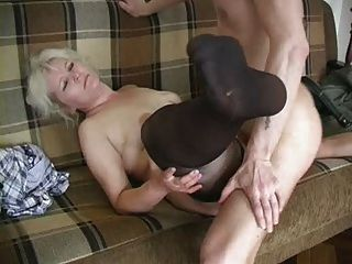 Mature Blonde In Stockings Fucks The Boy