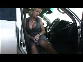 Busty In Stockings In The Car