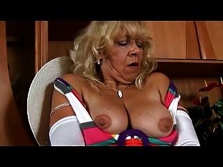 Granny In White Stockings Plays With Pussy