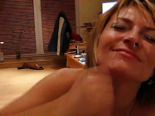 Horny Milf Jerks Off Her Hubby And Gets A Facial