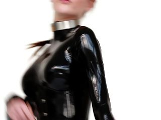 Model In Latex Catsuit And Ballet Boots.