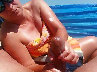 Handjob On The Beach With Big Cumshot By Hot Milf