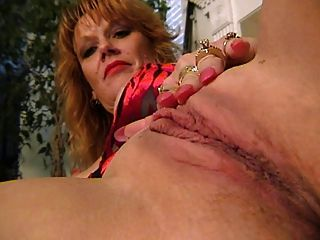 Mature Redhead Fingers Herself
