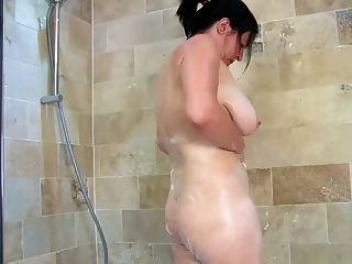 English Mature Bathes Her Giant Tits & Hairy Pussy