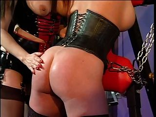 Big Tits Redhead And Her Mistress Into A Bdsm Session