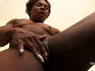 Ebony Female Bodybuilder Flexing And Toying