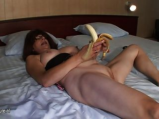 Mature beauty fucks banana cock