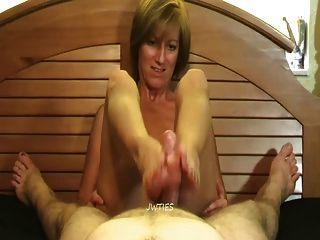 Mature footjob in pants
