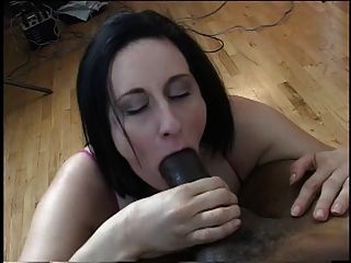Brunette With Big Tits Sucks On A Massive Black Cock On Her Knees