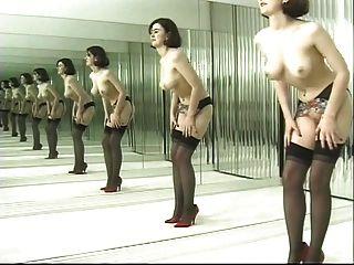 Playful Brunette Dances In Black Stockings