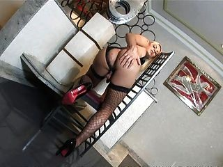 Tranny Thays In Fishnet Stockings Strokes Her Cock