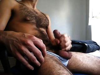 Hairy guy jacking off