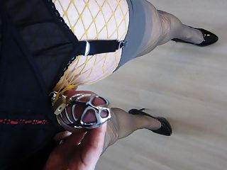 Walking In High Heels With Caged Cum