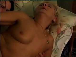 Blonde Granny In White Stockings Calls Over A Young Boy