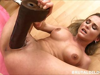 Busty Blonde With Giant Dildo