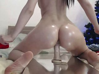 Oiled Up Girl Rides Dildo