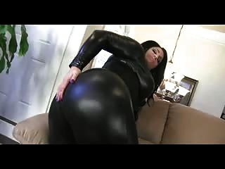 Curvy Brunette Shows Off Huge Ass In Leather Catsuite