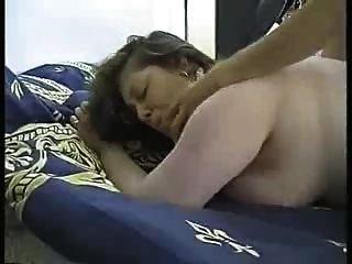 Hairy girl rubs pussy