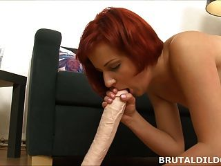 Redhead Teen With A Brutal Dildo