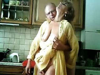Old German Couple In The Kitchen