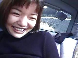 Two Japanese Girls In A Car