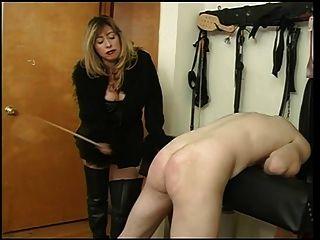 Mistress Cristian Spanking Her Slave Dude