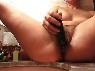 Horny Chick Fucking Herself With Cucumber On The Sink