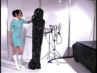 Sexy Brunette Covered In Rubber