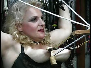 Busty Blonde Gets Her Tits Abused, Plays With Ropes In The Dungeon