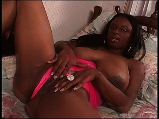 Hot Black Chick With Large Breasts Rubs Her Pussy