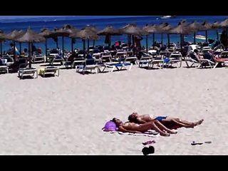 Beach Sun Bathing Couple