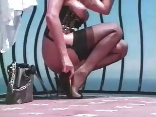On The Balcony Toying In Full Fashion Stockings