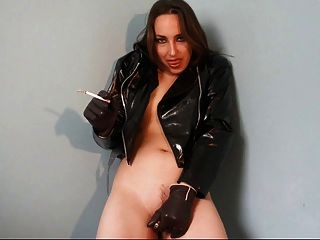Hot Babe In Leather And Vinyl Smoking And Diddling