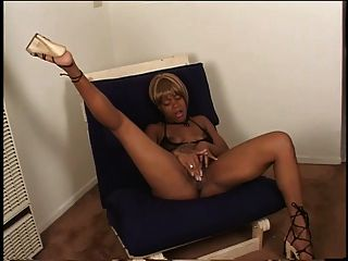 Sexy Ebony In Heels Fingers Her Juicy Pussy On A Chair