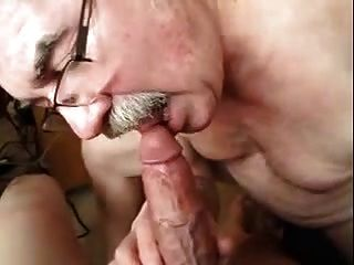 Old Men Playing With A Cock