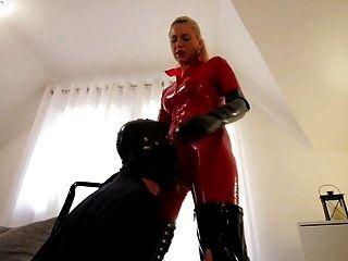 Slut In Red Latex Cat Suit Black Boots Fucks Slave
