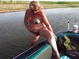 Mature Pees Beside Boat