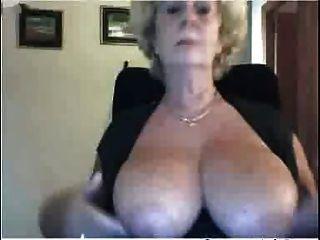 Naked old woman at beach